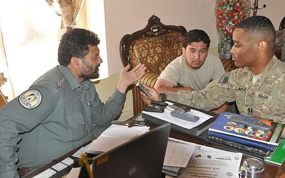 Capt. Westly LaFitte, right, records a statement by Ghulam Sakhi, left, the police chief of Logar province, that will be broadcast over the radio in villages across Logar.
