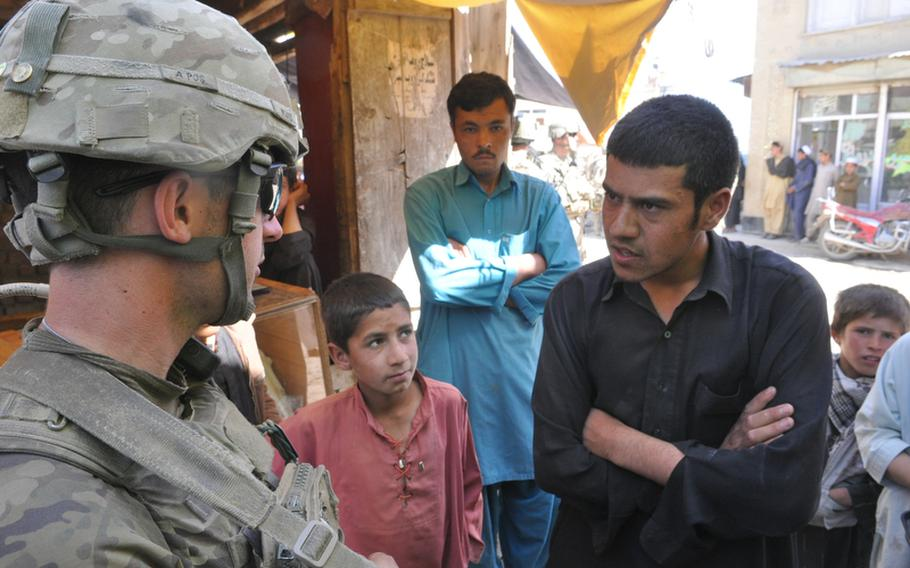 """During a recent patrol in the Baraki Rajan bazaar in Logar province, 1st. Lt. Patrick McGrath was accosted by a teenager who demanded to know why non-Muslims were in his country. """"We're here because we want to help provide security in Afghanistan,"""" McGrath replied."""