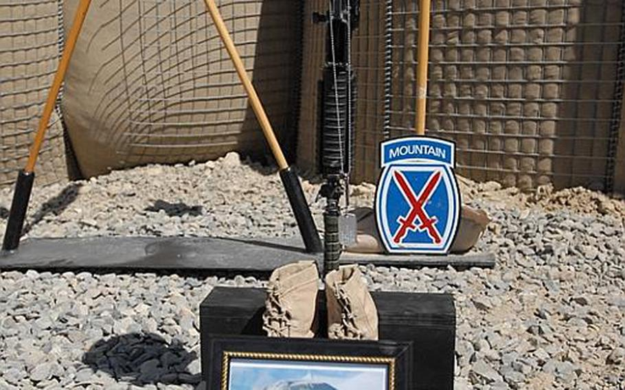 Photograph of Private 1st Class Brandon Owens at a memorial service for him and Sgt. Aaron Smith, who were killed Oct. 2, 2009, by an Afghan police officer known to Americans as Crazy Joe.