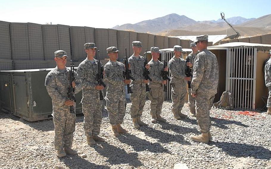 Spc. Justin Chavez, left, and other soldiers in an honor guard at the memorial service for Sgt. Aaron Smith, left, and Private 1st Class Brandon Owens, who were killed Oct. 2, 2009 by an Afghan police officer known to Americans as ?Crazy Joe.?