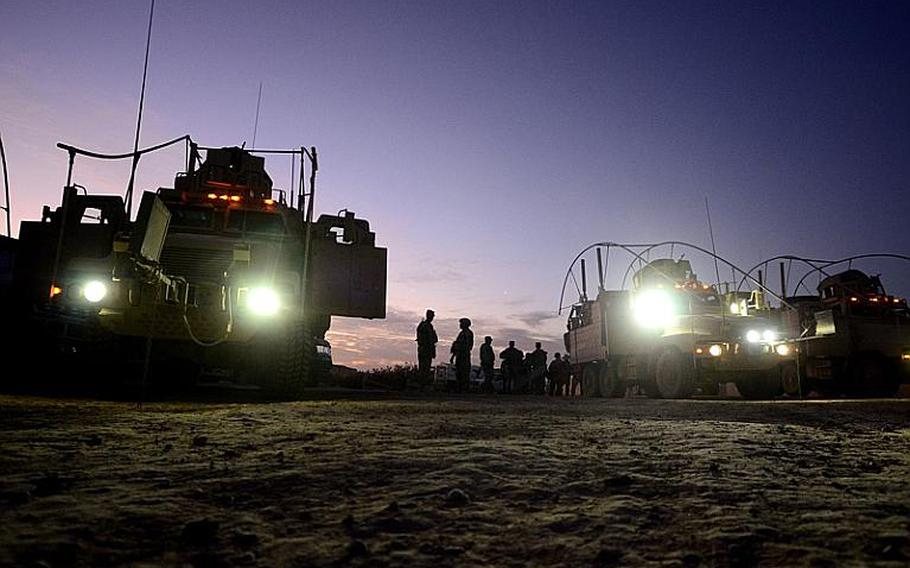 Soldiers from 2nd Battalion, 5th Cavalry Regiment, 1st Brigade, 1st Cavalry Division, prepare to conduct a night patrol from Contingency Operating Station Kalsu near the city of Hilla, Iraq.