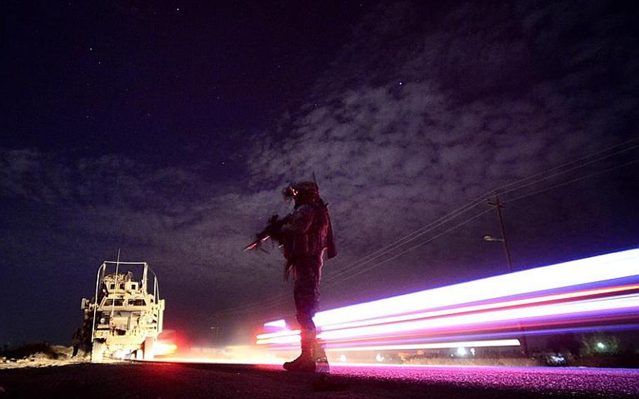 Sgt. Steven Spurrell, with 2nd Battalion, 5th Cavalry Regiment, 1st Brigade, 1st Cavalry Division, scans the area during a night patrol from Contingency Operating Station Kalsu near the city of Hilla, Iraq.