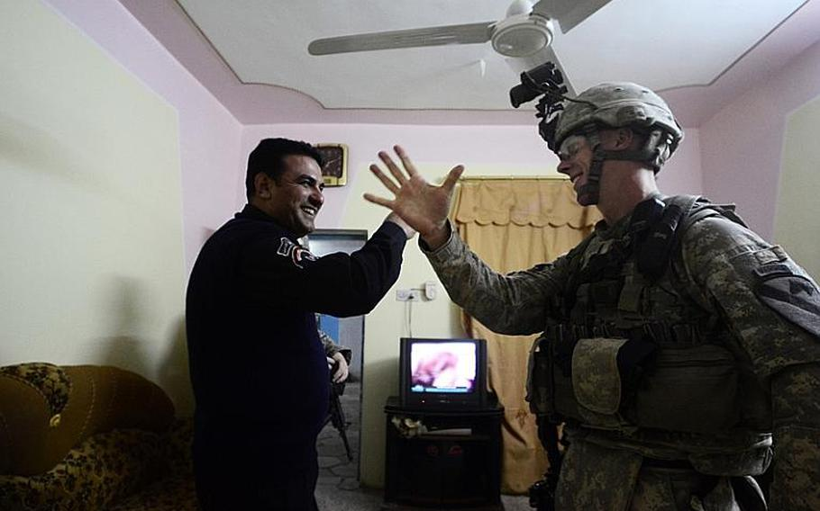 First Lt. David Coleman, with 2nd Battalion, 5th Cavalry Regiment, 1st Brigade, 1st Cavalry Division, visits an Iraqi police station during a night patrol conducted from Contingency Operating Station Kalsu near the city of Hilla, Iraq.