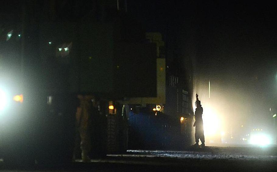 A group of U.S. soldiers in the last convoy to leave Iraq file through the Kuwait border at the Khabari crossing.