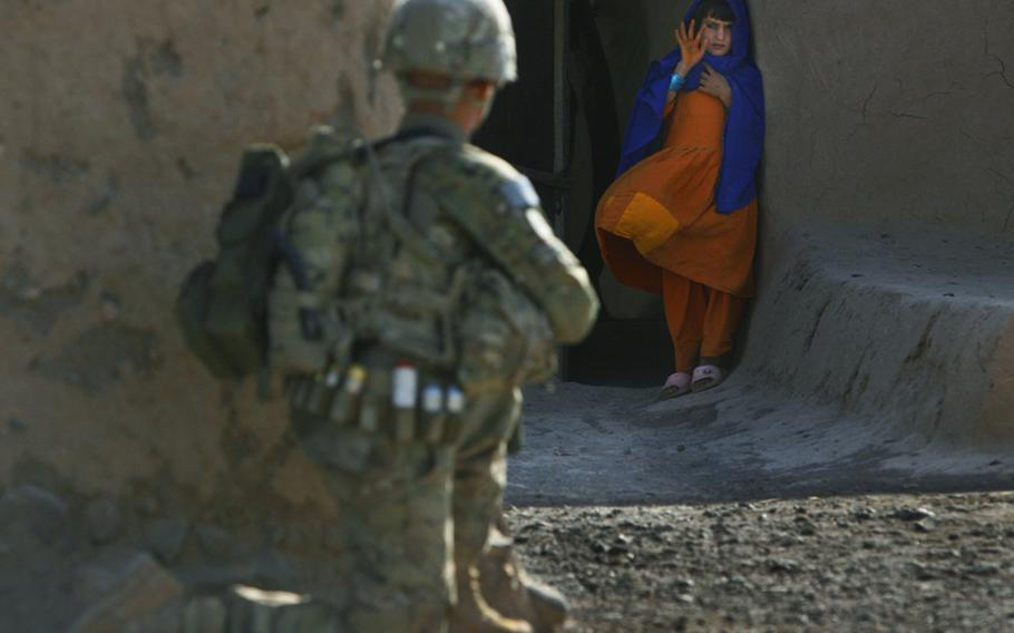 An Afghan girl waves to Pfc. Mackenzie Wilson of Company F, 4th Battalion, 101st Aviation Regiment, 159th Combat Aviation Brigade, 101st Airborne Division, who was patrolling her village of Loy Shur on Sept. 23, 2011, in Zabul province, Afghanistan.