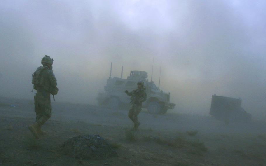 Pathfinders with Company F, 4th Battalion, 101st Aviation Regiment, 159th Combat Aviation Brigade, 101st Airborne Division, link up with their vehicles after being dropped in by Chinook helicopters for a mission on Sept. 23, 2011, in Zabul province, Afghanistan.