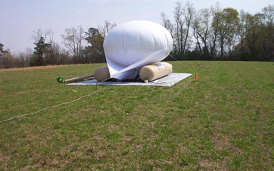 The U.S. military is testing a small aerostat known as a Helikite to see if the device could be used to lift surveillance cameras and communications equipment high above small outposts in Afghanistan.
