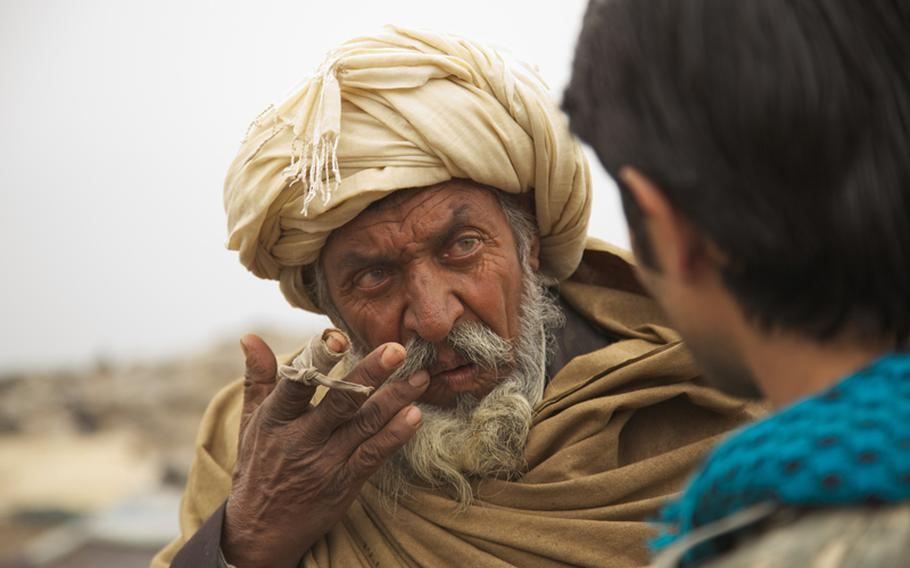 An elder from the Kuchi tribe in Afghanistan listens as an interpreter explains a U.S. Army medic's recommendation for treating his wife's painful scalp cysts. The condition likely resulted poor hygiene, said Spc. Victor Cornejo, 34, a medic from Palm Springs, Calif., who examined the woman.