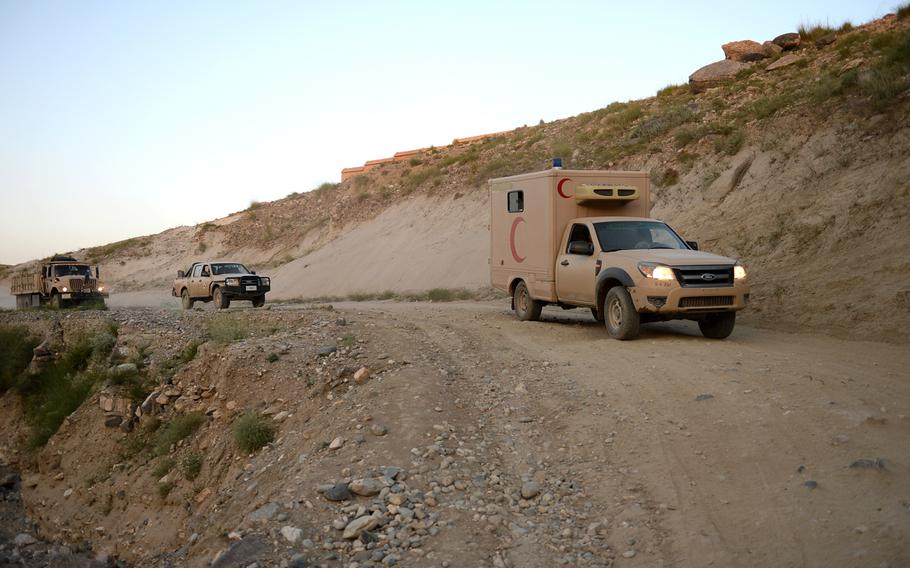 An Afghan army ambulance drives as part of a convoy to the front lines of an operation in Nangarhar province on Aug. 17, 2015. Most medical evacuations for Afghan police and soldiers rely on such vehicles.