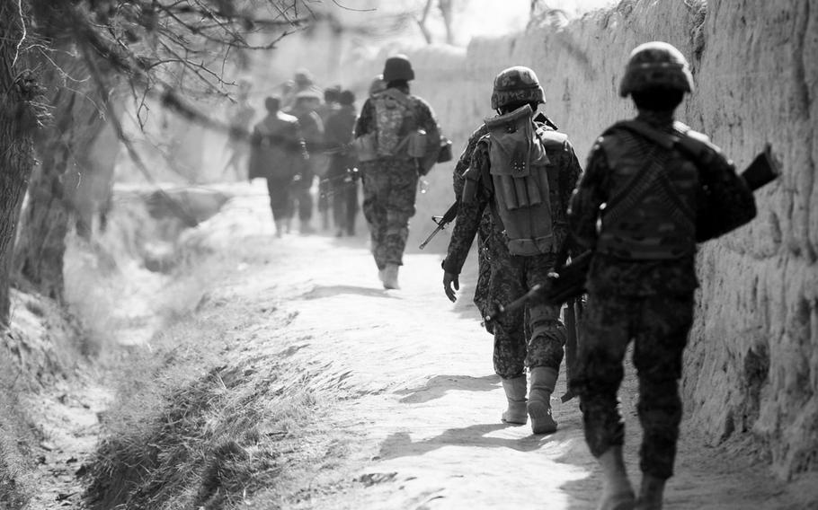 Afghan security forces patrol a village in Panjwai district, once known as part of the 'Birthplace of the Taliban.' Despite its bloody history, Panjwai and surrounding districts have become something of a bright spot with residents increasingly supporting the central government.