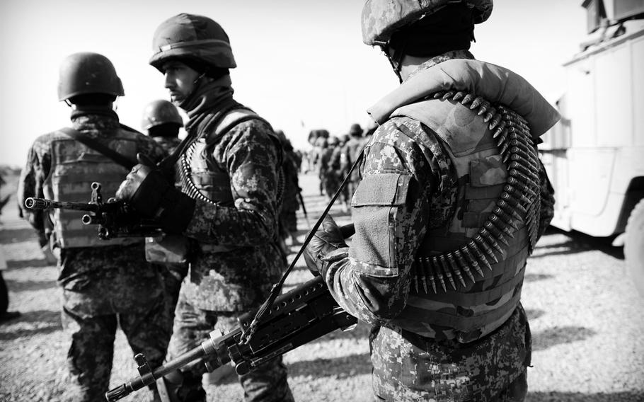 Afghan National Army soldiers join local police to patrol a village in Panjwai district in southern Afghanistan on Jan. 5, 2015. Once known as a hotbed of insurgent activity, residents and security officials alike say the district has become more supportive of the national government.