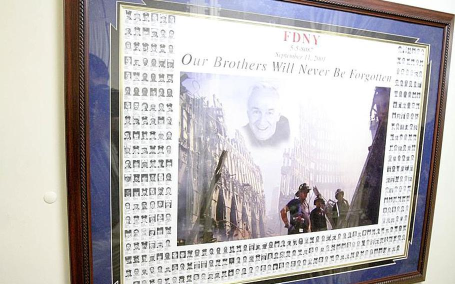 Each morning Lt. Justin Bernard, the chaplain aboard the USS New York, gets a name from this picture outside his office with all 343 firefighters who died on  9/11. He researches the firefighter and prays for him in his evening prayer each night the ship is at sea.