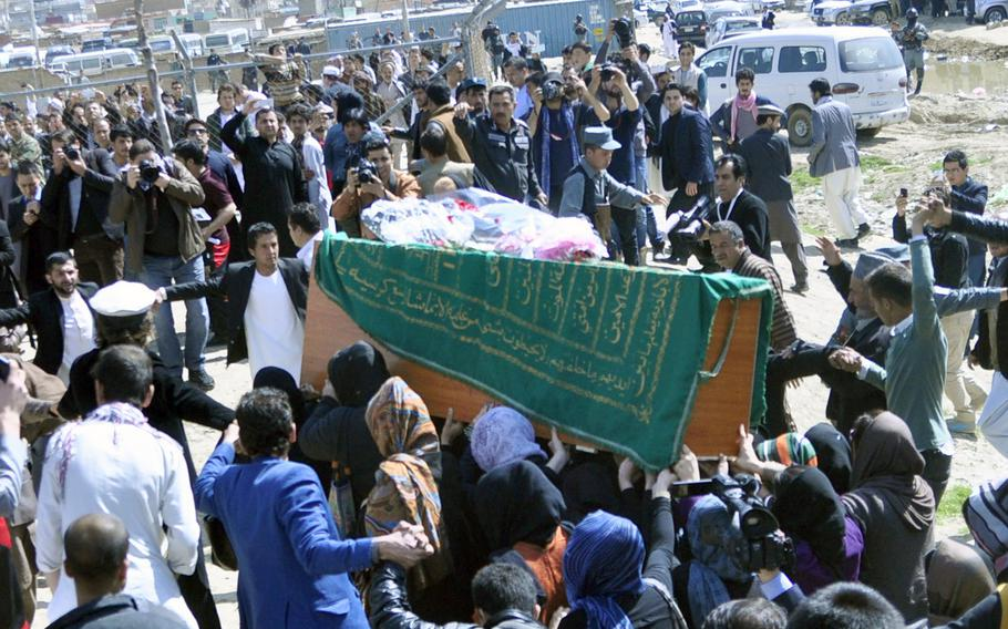 Women carry the coffin with the remains of 27-year-old Farkhunda, a young woman killed and then burned by a mob of men in downtown Kabul on March 19, 2015. The role of pallbearer is usually restricted to men, but women activists took the unusual step to show solidarity and protest violence against women.
