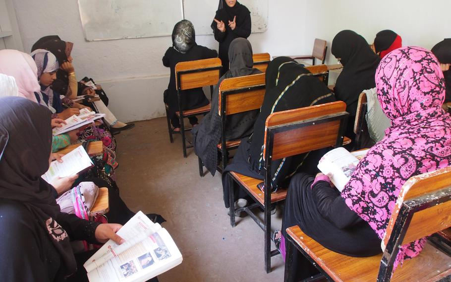 A teacher conducts a class at the Kandahar Institute of Modern Studies, a private co-educational school in a city that is the Taliban's spiritual heartland on July 17, 2014. Ehsanullah Ehsan, the school's founder, says he still gets death threats for his outspoken views on girls' education.