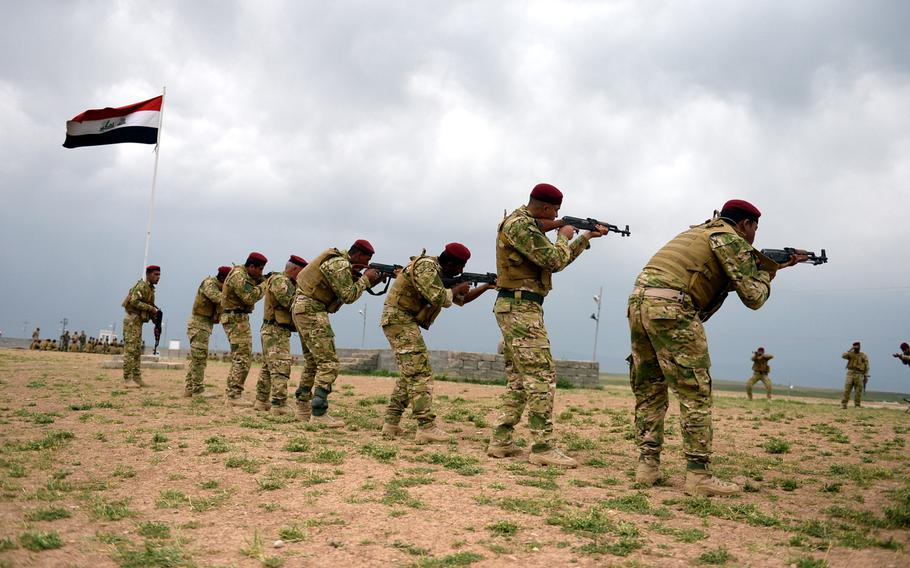 Volunteer in the fight against the Islamic State, mostly from minority groups like Sunni Muslims, Christians, and Yezidis, practice at a training camp in northern Iraq. While thousands of volunteers  have been trained at the camp, most have been sent home to wait until weapons can be procured.