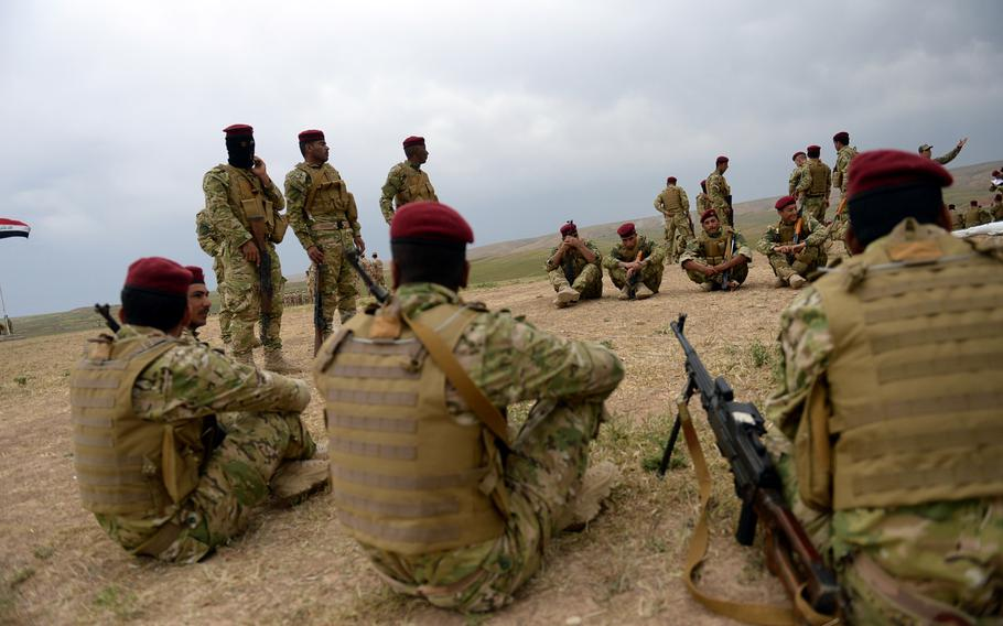 New recruits in the fight against the Islamic State group listen to a lesson at a training camp in northern Iraq. Waves of volunteers arrive every three weeks, but leaders say they don't have enough weapons to arm the new forces.