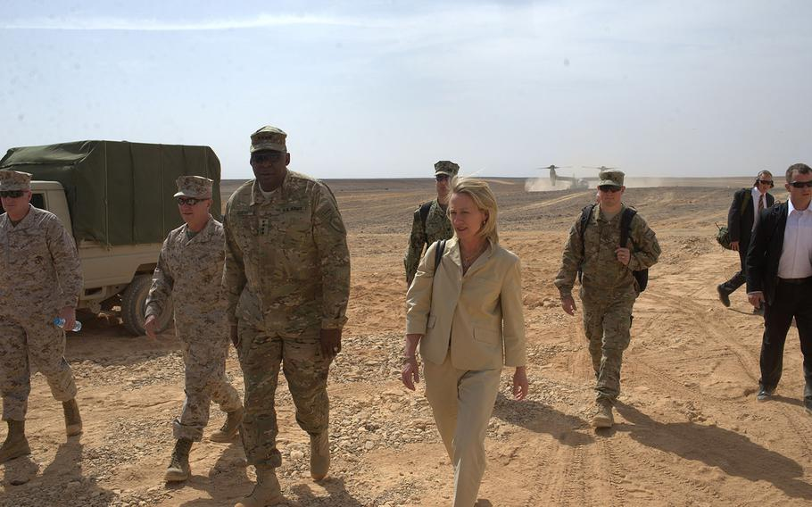 U.S. Army Gen. Lloyd Austin, left, and U.S. ambassador to Jordan Alice Wells arrive at a demonstration of military firepower at the Wadi Shadiya training range in Jordan on Monday, May, 18, 2015. The event, which included a B-52 bombing, was the culminating act of the multinational exercise Eager Lion.