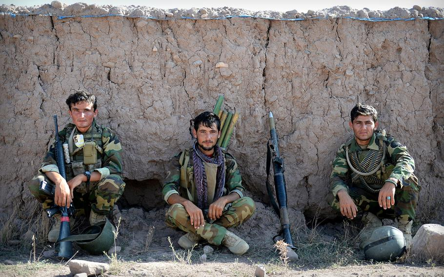 Afghan National Army soldiers rest before an operation in Nangarhar province in August 2015. Between high rates of desertion and casualties, Afghan security forces are losing as many as 4,000 members per month, according to U.S. officials.