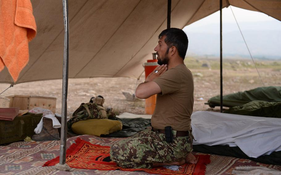 An Afghan soldier says his morning prayers at a forward camp during an operation in rural Nangarhar province in August 2015. Afghan forces have taken increasing losses as they have led the fight against the Taliban and other insurgents.