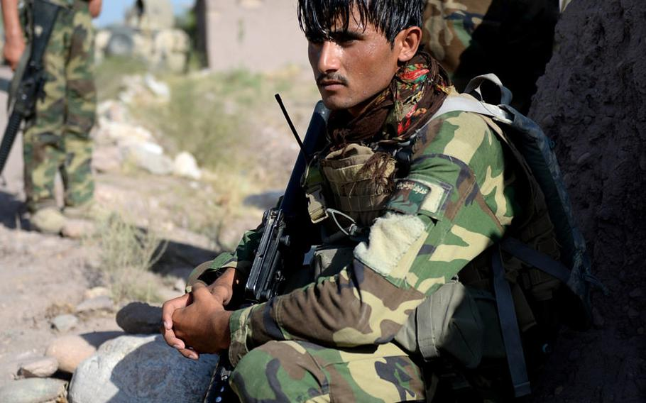 An Afghan National Army soldier rests before an assault on a Taliban compound in Nangarhar province in August 2015. Losses among Afghan security forces have increased as the insurgency continues.