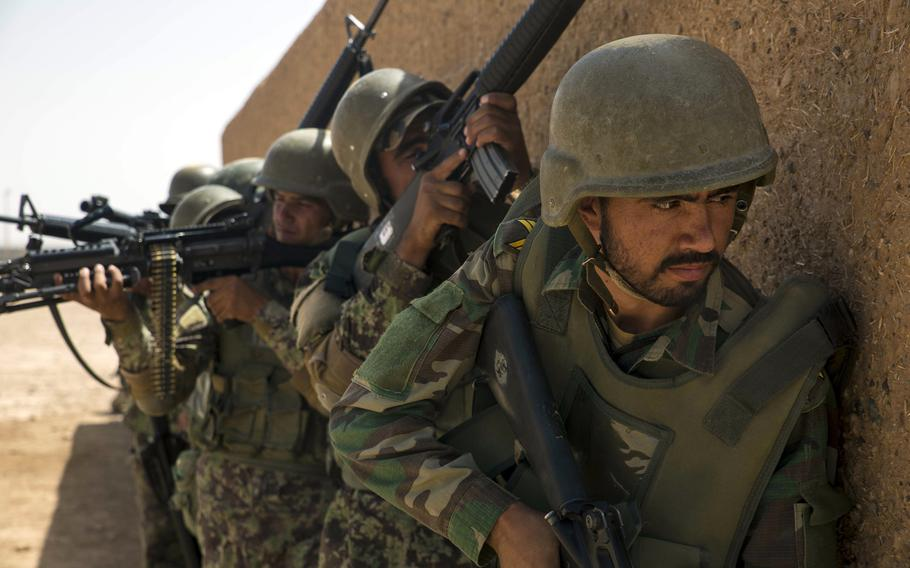 Afghan soldiers prepare to enter a building during an exercise at Camp Shorabak in July 2018. According to the Special Inspector General for Afghanistan Reconstruction, the country's  forces are preventing the Taliban from capturing more territory, but are finding it difficult to extend their own area of control.
