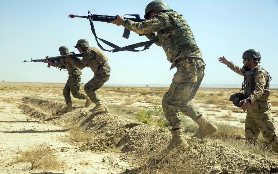 Afghan soldiers move as a squad during training at Camp Shorabak in June, 2018.  The Special Inspector General for Afghanistan Reconstruction, says the country's  forces are preventing the Taliban from capturing more territory, but are finding it difficult to extend their own area of control.