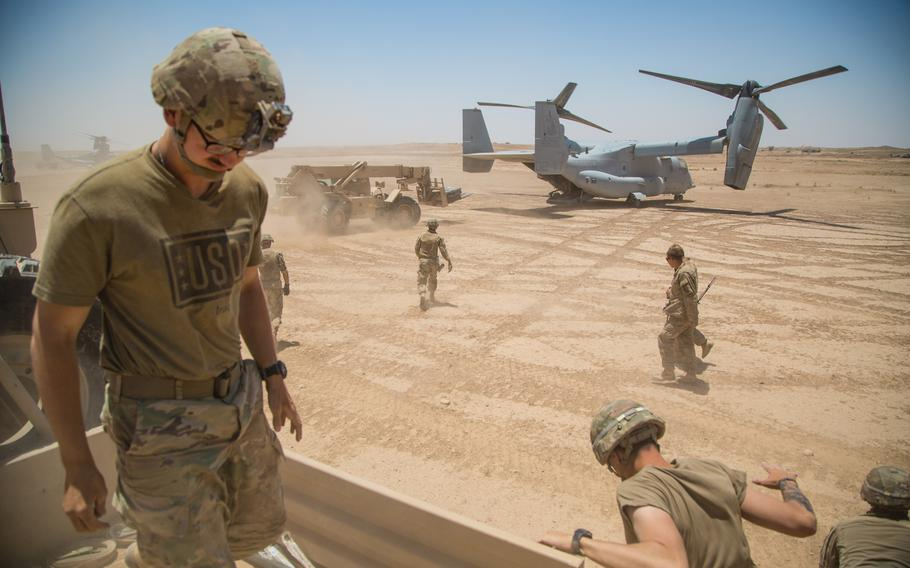 A U.S. Marine Corps MV-22 lands at a remote location near the Iraqi-Syrian border to resupply Marines and soldiers with the 3rd Cavalry Regiment, June 23, 2018. Iraqi Security Forces and coalition partners provided fire support to assist the Syrian Democratic Forces as they continue Operation Roundup, the military offensive to accelerate the defeat of ISIS remnants in the Middle Euphrates River Valley and Iraq-Syria border region.