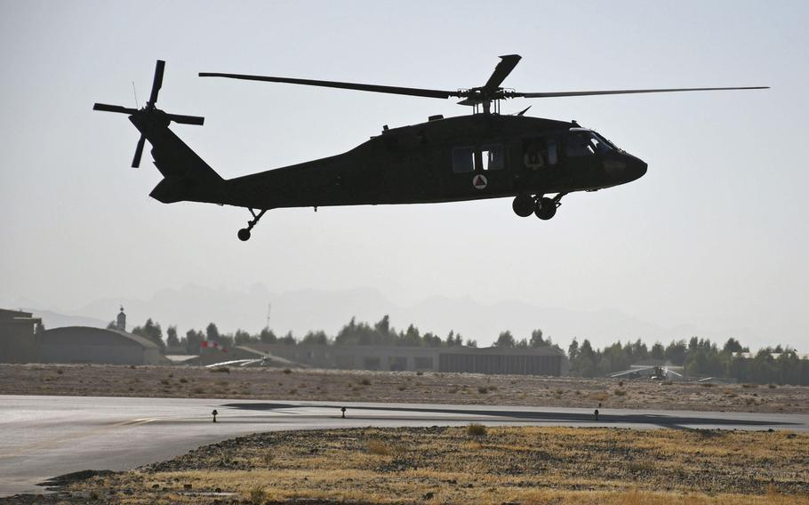 An Afghan pilot practices flying one of Afghanistan's new UH-60 Black Hawk helicopters at Kandahar Air Field on Sunday, Nov. 5, 2017.