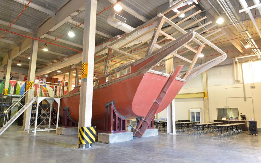 A fishing dhow rests in a facility used to train US and partner nations on ship boarding procedures on March 12, 2019 in Bahrain. The facility is known as the ship-in-a-box and serves as platform for the Coast Guard, Navy and partner nations to share best practices for visit, board, search and seizure tactics.