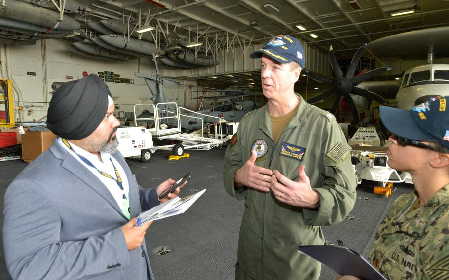 U.S. Navy Capt. Patrick Thompson, executive officer for the aircraft carrier USS John C. Stennis, speaks with reporters on Monday, March 25, 2019, in Manama, Bahrain. Stennis' crew of approximately 5,000 sailors is in Bahrain for rest and relaxation during a scheduled deployment to both 5th and 7th Fleet areas of operations.