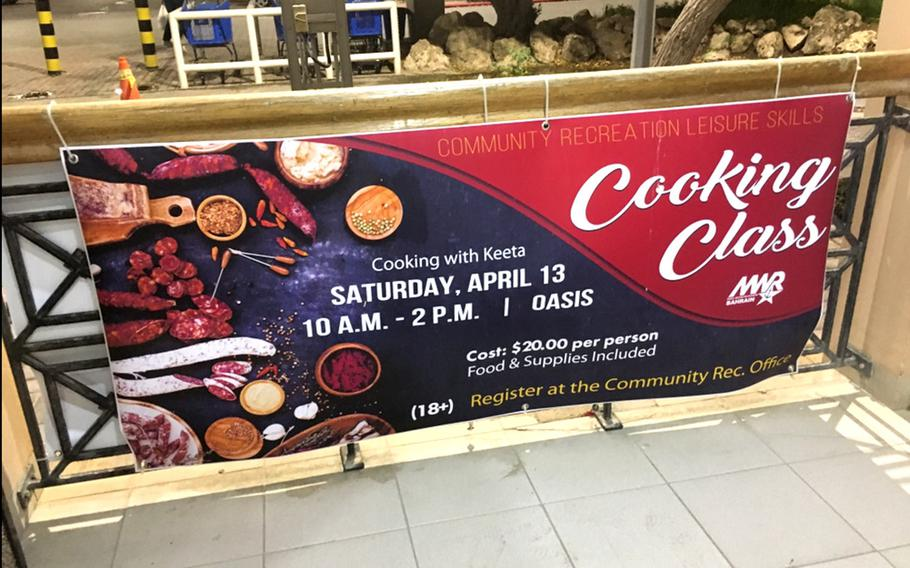 A sign displays cooking classes at the main gate for Naval Support Activity Bahrain. Chief Petty Officer Markeeta Hardin, also known as Chef Keeta, has been cooking most of her life.