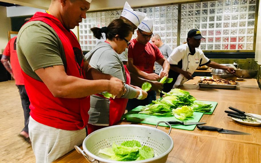 Students prep vegetables during a cooking class at Naval Support Activity Bahrain on April 15, 2019. Chief Petty Officer Markeeta Hardin, also known as Chef Keeta, has been cooking for most of her life. The 19-year security forces chief spends her off-time volunteering and serving up soul food to both servicemembers and locals through her Friday brunches, cooking classes and private events.