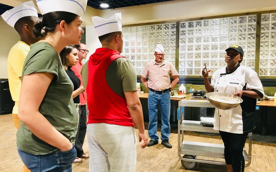 Chief Petty Officer and chef Markeeta Hardin speaks to students during a cooking class at Naval Support Activity Bahrain on April 15, 2019. Hardin, also known as Chef Keeta, has been cooking most of her life. The 19-year security forces chief spends her off-time volunteering and serving up soul food to both servicemembers and locals through her Friday brunches, cooking classes and private events.