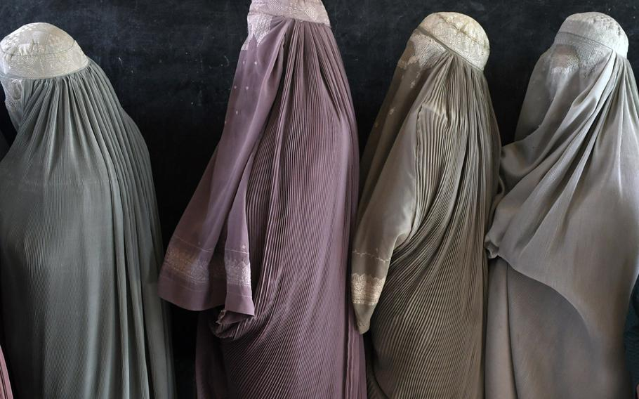 Women wait in line to vote at a polling center in Kandahar, Afghanistan in 2018. The Taliban have refuted a report that women will be included in their delegation attending peace negotiations in Qatar later this week.