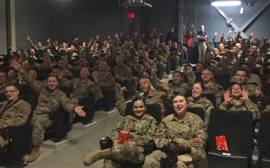 """Troops deployed to Bagram Air Field, Afghanistan, await the movie """"Avengers: Endgame"""" on May 1, 2019. Disney agreed to send the film to Bagram and Qatar Air Base after a military spouse tweeted to the company's CEO."""