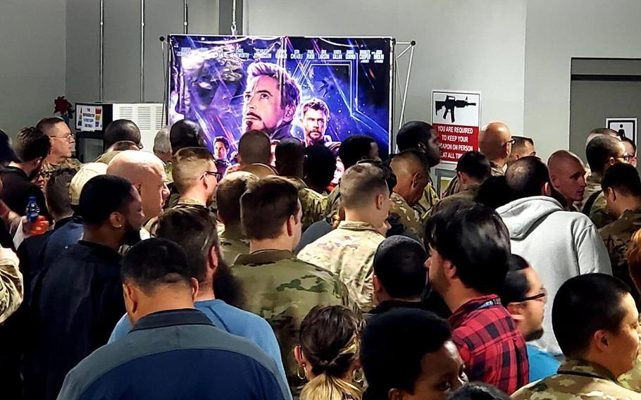"""Troops deployed to Bagram Air Field, Afghanistan, line up to watch the movie """"Avengers: Endgame"""" on May 1, 2019."""