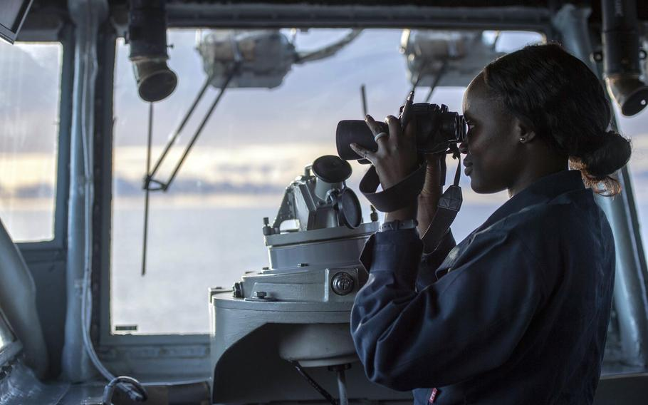 Ensign Marieme Gueye, aboard the amphibious assault ship USS Boxer, stands watch on the bridge in the Indian Ocean, Friday, June 21, 2019.  The Boxer Amphibious Ready Group and 11th Marine Expeditionary Unit arrived in the U.S. 5th Fleet area of operations, Monday, June 24, 2019, relieving the Kearsarge ARG and 22nd MEU.