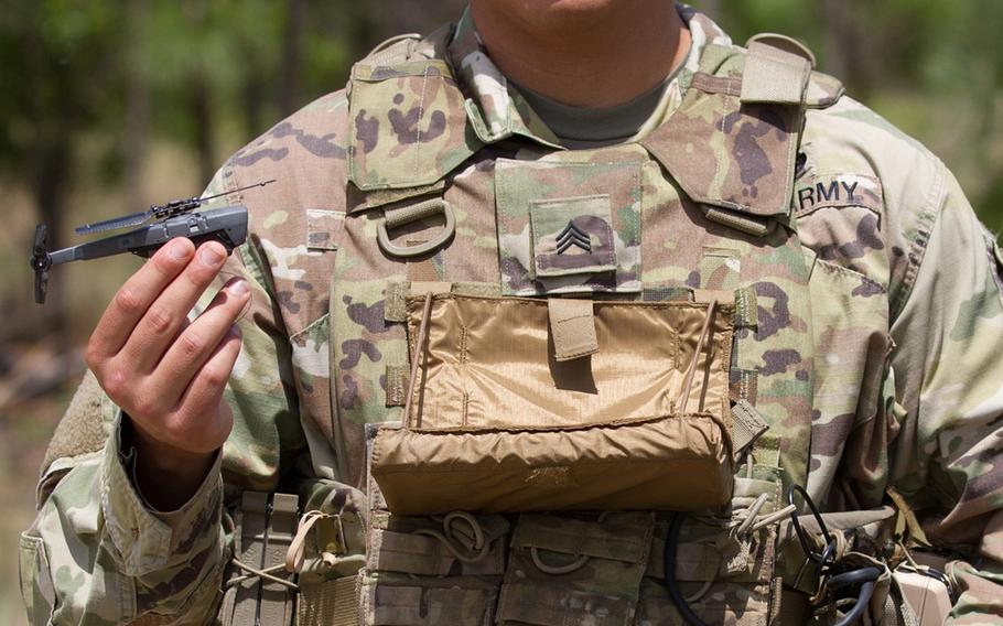 SGT Richard Molina, B. Co., 3rd Brigade Combat Team, 82nd Airborne Division, shows off the Soldier Borne Sensors system during its initial fielding at Ft. Bragg, N.C., May 2, 2019. The system contains a base station, hand controller, display, and two air vehicles, all man-portable.