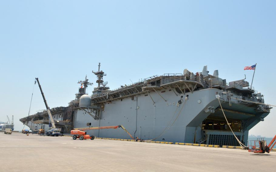 The amphibious assault ship USS Boxer is seen pierside at Bahrain's Khalifa bin Salman Port on Aug. 1, 2019. The Boxer pulled into Bahrain on July 25 for a scheduled weeklong port visit just days after making headlines for downing at least one drone during inbound transit through the Strait of Hormuz.