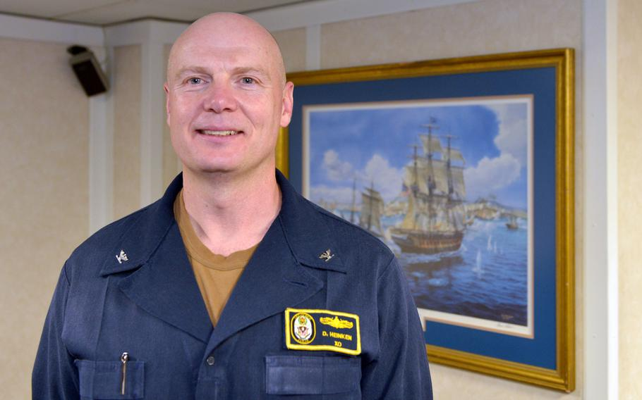Capt. Dale Heinken, executive officer on board the amphibious assault ship USS boxer, poses for a photo on Aug. 1, 2019.