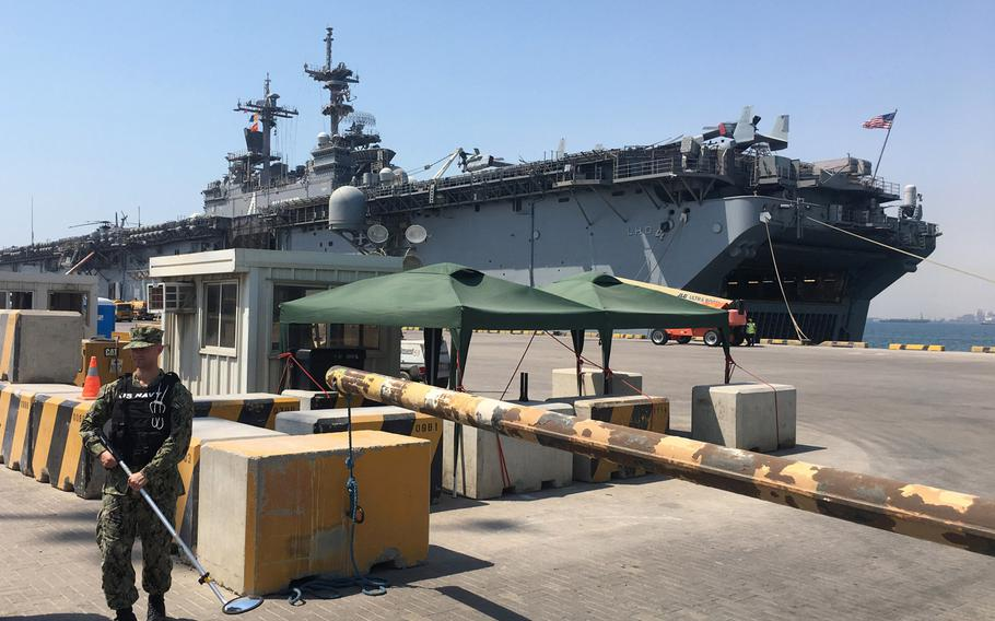 The amphibious assault ship USS Boxer is seen in Bahrain's Khalifa bin Salman Port on Aug. 1, 2019. Boxer pulled into Bahrain on July 25 for a scheduled weeklong port visit just days after crew members downed at least one drone during inbound transit through the Strait of Hormuz on July 18.