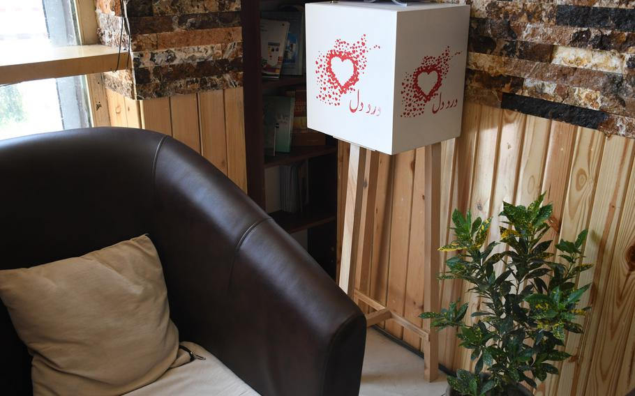 A letter box for the Dard-e-Dil campaign, which aims to share Afghans' worries and recommendations with negotiators at peace talks, stands in a Kabul cafe on Thursday, Aug. 1, 2019.