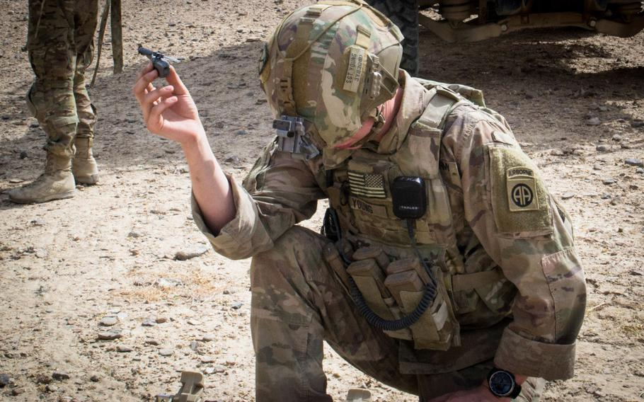 A paratrooper from the 3rd Brigade Combat Team, 82nd Airborne Division, prepares to launch a Black Hornet personal drone Friday, Aug. 9, 2019, in Kandahar, Afghanistan in support of a foot patrol. The 3rd Brigade is the first Army brigade to use the personal drones.