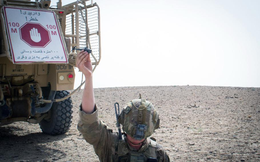 A paratrooper from the 3rd Brigade Combat Team, 82nd Airborne Division, prepares to launch a Black Hornet personal drone Friday, August 9, 2019, in Kandahar, Afghanistan, in support of a foot patrol.