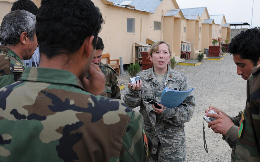 U.S. Air Force Maj. Christy Barry speaks Dari with Afghan National Army officers in 2009, at the Counter Insurgency Training Academy on Camp Julien, Afghanistan.