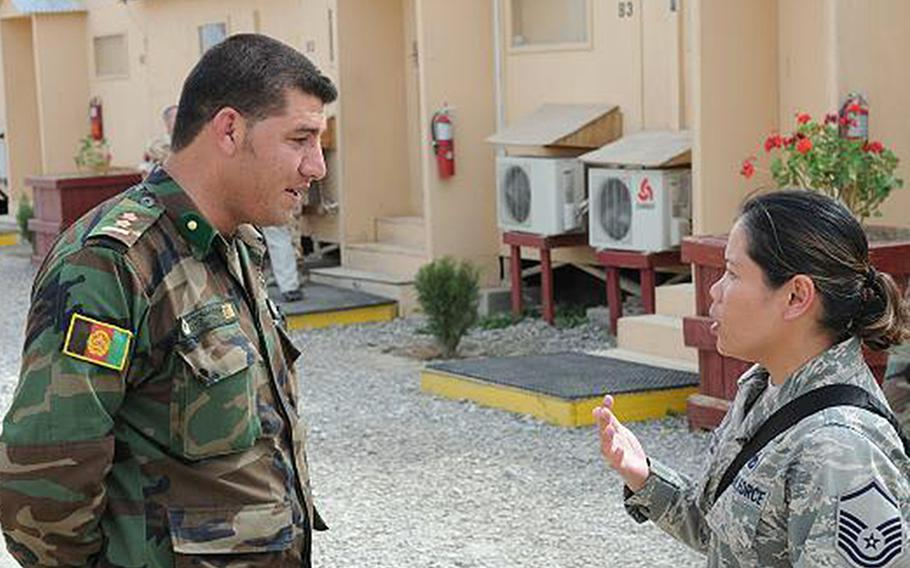U.S. Air Force Master Sgt. Irene Mason talks with an Afghan soldier on Camp Julien, Afghanistan, in 2009. The Afghanistan-Pakistan Hands program launched by the Defense Department  in September 2009 to develop a cadre of experts in the countries, including their languages and cultures, is set to end in 2020.