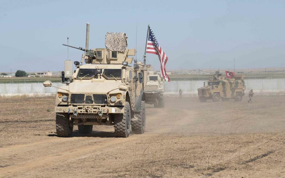 U.S. and Turkish military forces conduct a joint ground patrol in northeast Syria on Sunday, Sept. 8, 2019, to observe progress on destroyed Kurdish militia fortifications and areas where Kurdish elements voluntarily departed.