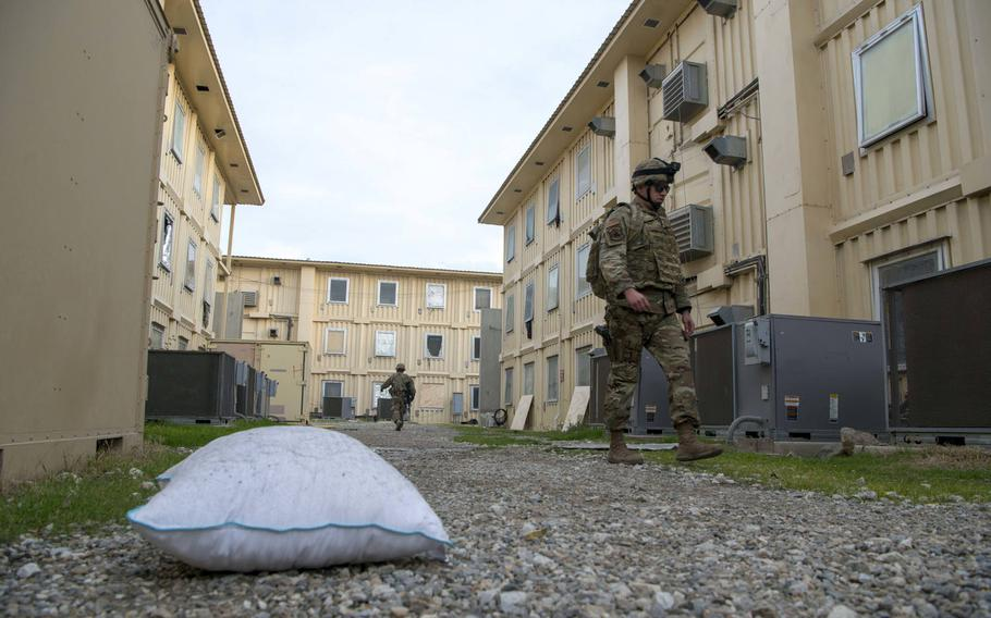 A pillow that was blown outside a service member's room lies on the ground while civil engineers from the 405th Expeditionary Support Squadron, 455th Air Expeditionary Wing, begin recovery operations at Bagram Airfield, Afghanistan, Dec. 11, 2019.