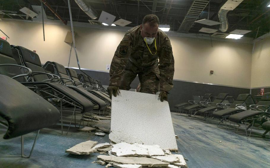 U.S. Air Force Tech. Sgt. Ryan Schell, a U.S. Central Command Materiel Recovery Element technician for the 405th Expeditionary Support Squadron, clears debris inside the passenger terminal the day after a Taliban attack at Bagram Airfield, Afghanistan, Dec. 12, 2019.