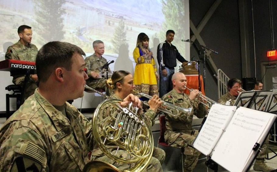 Afghan and American musicians assemble on Oct. 23, 2016, at Bagram Airfield. The two groups of musicians closed the show in a joint performance of two traditional Dari folk songs.